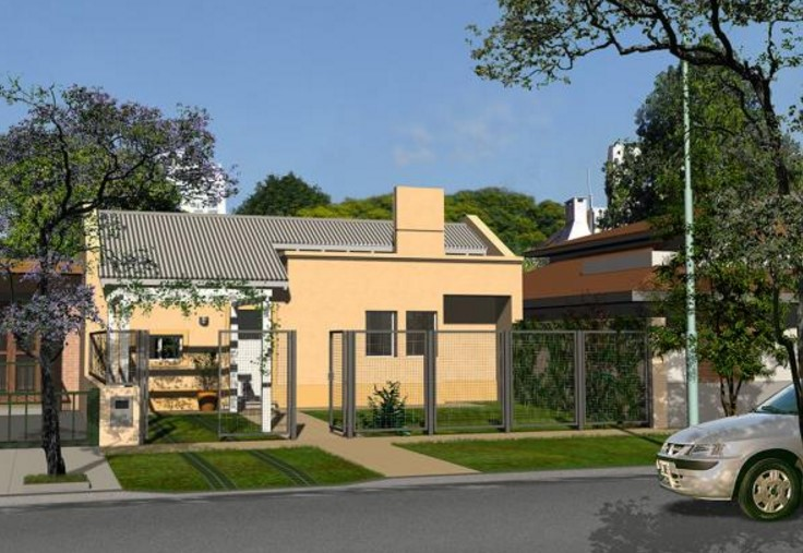 Modelo de casa con jard n frontal y rejas for Casas con jardin