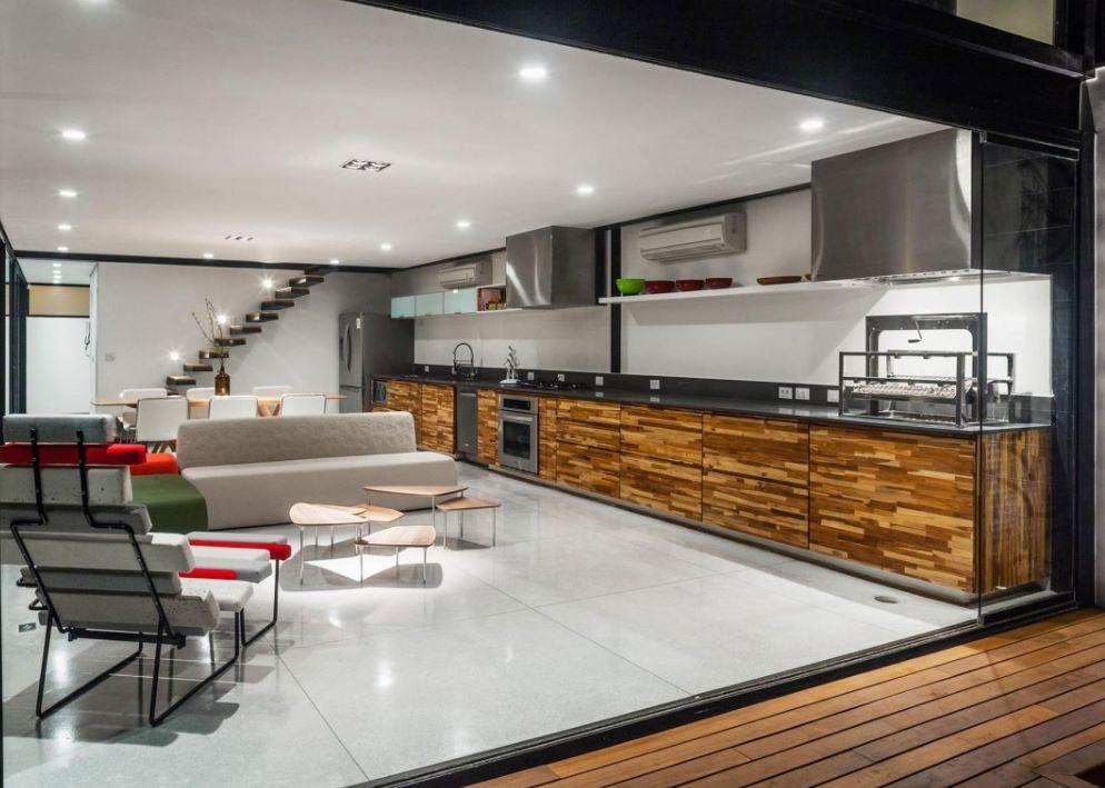 diseño de cocina moderna con comedor y living